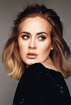 Adele's cat eye, bronzy lip color, and perfect hair cut are key elements in her signature retro beauty look