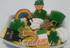 St.Patrick's day cookies,leprechaun, shamrocks, clovers,Guinness, beer, horseshoe, Irish flag, leprechaun's hat, sheep and pot of gold at the end of a rainbow