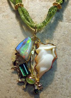 Carved drusy quartz, tourmaline, boulder opal on peridot beads in 22k & 18k gold.