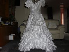 I Found this stunning wedding dress  abandoned and in tatters covered in mud on a mudy farm track trampled into the mud , i felt sorry for her , i felt it was my duty to rescue the poor wedding dress from her entrapment , so i began picking up every t mg