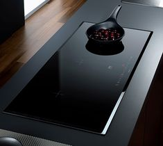 Induction cooktop.  I'd love this in my kitchen.