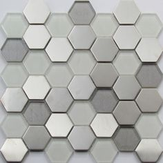 Brushed stainless steel mixed with glass mosaic tiles. These unique wall tiles are ideal for any feature wall or splashback. Modern Mosaic Tile, Hexagon Mosaic Tile, Glass Mosaic Tiles, Wall Tiles, Honeycomb Tile, Kitchen Facelift, Grey Grout, Floor Texture, Glass Bathroom