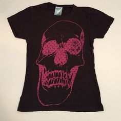 FREE WITH PURCHASE Black acid wash pink skull top SHIRT IS AS PICTURED. FREE WITH PURCHASE. IF YOU PURCHASE ANYTHING IN MY CLOSET MENTION YOU WANT TO INCLUDE THIS IN YOUR ORDER AND ILL ADD IT IN FOR FREE. ITEM CAN NOT BE ADDED WITH OTHER FREE WITH PURCHASE ITEMS. TO CALIM IT YOU MAY ALSO INCLUDE IT IN A BUNDLE AND MAKE ME AN OFFER SUBTRACTING THE COST OF THIS SHIRT AND I WILL ACCEPT. THAT WAY YOU WILL SEE IT IN YOUR ORDER. Loungefly Tops Tees - Short Sleeve