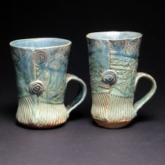 Qwirky mugs [by Mary Cloonan] for a qwirky couple - http://www.shop-baltimoreclayworks.org/collections/featured/products/pair-of-mugs-by-mary-cloonan-214
