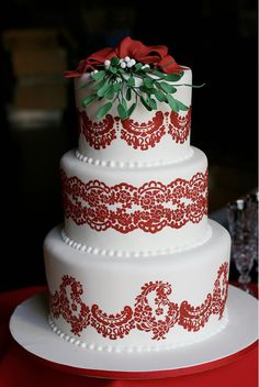 The perfect holiday wedding cake, topped with mistletoe. Pretty Please Bakeshop.