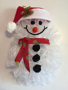 x Christmas/Winter Deco Mesh Snowman Wreath/Door Hanger with Santa Hat - RedNose& made with Chenille Stems. Ain& no man like a snowman& Add a little sparkle to your door with this cute little guy& Sure to bring smiles to all your friends and family& Snowman Christmas Decorations, Christmas Mesh Wreaths, Snowman Wreath, Deco Mesh Wreaths, Diy Christmas Gifts, Christmas Snowman, Handmade Christmas, Christmas Ornaments, Snowman Crafts