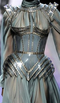 Jean Paul Gaultier. Reminds me of Joan of Arc for some reason...Has this beautiful body armour to it that I can just picture of future for cosplay reference.