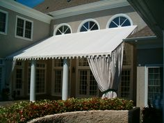 Stationary Patio Awning w/ Greek Key Valance and Accent Curtains on LKN. By Alpha Canvas & Awning. #alphacanvasawnings