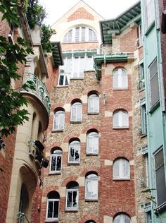 Le Castel Béranger, 14 rue la Fontaine - Paris, France XVI. Guimard's masterpiece of 1895-98 epitomises art nouveau in Paris. From outside you can see his love of brick and wrought iron, asymmetry and renunciation of harsh angles not found in nature. Green seahorses climb the façade, and the faces on the balconies are thought to be self-portraits, inspired by Japanese figures, to ward off evil spirits.  A must see.