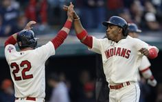 Cleveland Indians' Francisco Lindor, right, and Jason Kipnis celebrate after both score on a two-RBI-double from Mike Napoli in the first inning of a baseball game against the Detroit Tigers, Tuesday, May 3, 2016, in Cleveland. (AP Photo/Tony Dejak)