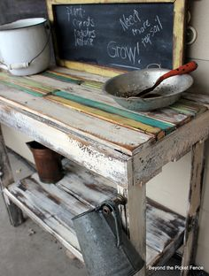 Beyond The Picket Fence: Pallet Potting(db- how about as a hall bench for the cell phone chargers ?)