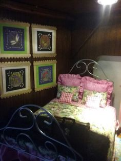 Barbie's bed. The bed is from the GAW and I made another blanket and more pillows. I also made the wall hangings.
