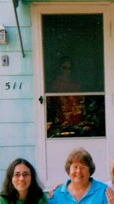 "Front Door Ghost: Supposedly, there was no living person standing in the doorway when this picture was taken. The family reportedly experienced a ""friendly"" ghost in the house."