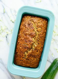 Zucchini loaf made with lots of fresh zucchini, honey, coconut oil, whole wheat flour and nuts! cookieandkate.com