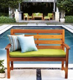 Pretty bench, love that you can change the pillows for a different look each summer.