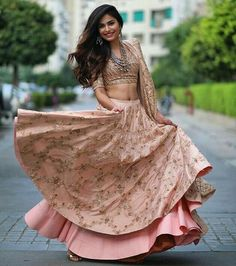 Save this peach lehenga design for the no fuss bridal look. It's light, it's fabulous and it's the right choice. | Silk lehenga | pale peach and pink quarter sleeves | twirling bride | Photo Source: (pinned by) Siddhi Powale| Every Indian bride's Fav. Wedding E-magazine to read. Here for any marriage advice you need |www.wittyvows.comshares things no one tells brides, covers real weddings, ideas, inspirations, design trends and the right vendors, candid photographers etc.