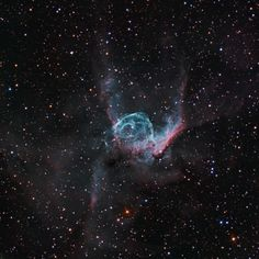 Thor's Helmet is an interstellar bubble about 15,000 light-years from Earth located in the constellation Canis Major. Cataloged as NGC 2359, it is the result of a pre-supernova Wolf-Rayet star sweeping its surrounding molecular cloud.