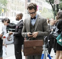 Your average looking business hipster in the Zuckerberg era. Looks good, please however let him have proper fitting trousers and no naked ankles. Finish off with business shoes.