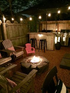 Back yard make over with pea gravel, gas fire pit, and outdoor bar