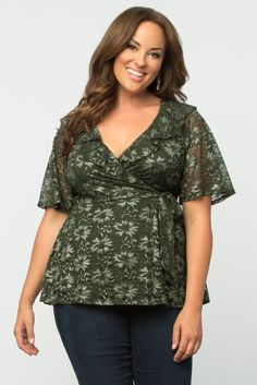 If you love wrap dresses, you'll love our plus size Lustrous Lace Top. This fully-functional wrap design allows you to wear it the way that feels comfortable to you. Pretty lace floral details and a ruffled neckline add a touch of romance to this beautiful top. Made in the USA. www.kiyonna.com