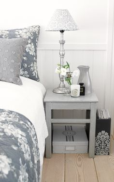 Gray and white bedroom vignette, natural wood floors, beadboard wainscoting