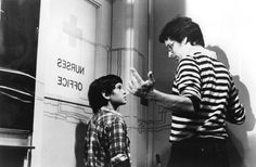 steven spielberg and henry thomas (elliot) on the set of E.T