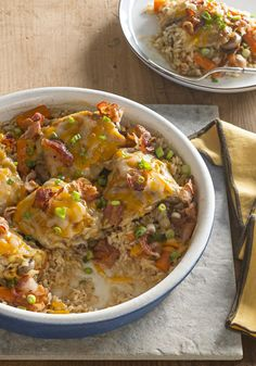 Brown Rice & Chicken Bake -- How do you make a chicken-and-rice bake recipe exciting? We did it by using brown rice and chicken thighs for a change. Then we added bacon and melty cheese.