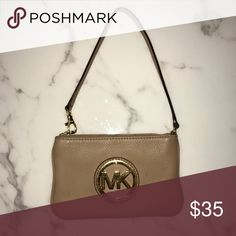 "⚠️LAST CHANCE⚠️ Michael Kors Beige Zipper Wristlet Purchased from Nordstrom a few years ago- in very good condition but I did take close ups of two tiny marks on it. Very hard to notice in the first picture. I'd describe the color as camel, but technically per MK it's ""peanut."" Not a bad description as it's a very light neutral. I used to clip the strap differently- shown in second pic. Two pockets on the inside! MICHAEL Michael Kors Bags Clutches & Wristlets"