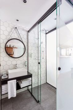 A honeycomb backsplash tile. Black and white bathroom decor Bathroom Renos, Laundry In Bathroom, White Bathroom, Bathroom Interior, Bathroom Ideas, Vanity Bathroom, Shower Ideas, Bathroom Inspo, Bathroom Remodeling