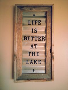 Rustic sign made with an old frame, sheet metal, & adhesive letters! Perfect for living on the lake!!