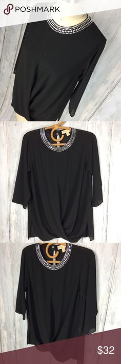 "MICHAEL KORS Sheer Blouse with Glass Beads Blk XS Absolutely stunning and in like-new condition. This is a sheet black blouse with a lovely cross over detail in front and glass embellishment at neckline. 3/4 sleeves, 100% Polyester.   Armpit to armpit: 19"" Length: 27"" Armpit to sleeve hem: 13""  Thank you for looking, check out my other items! Michael Kors Tops Blouses"