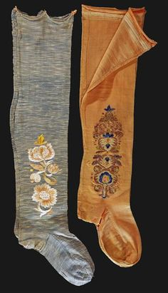Two pairs of stockings, c. 1750. Silk stockings with floral silk embroidery. Museu Nacional do Traje