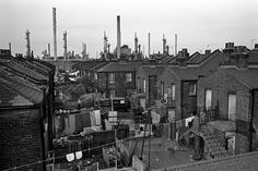 Photograph by Tony Bock. Possibly Canning Town or Silvertown, Royal Docks area East of Greenwich/Blackwall. Not the East End, but East London, two slightly different things.