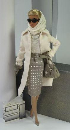 This set includes coat in cream micro suede wide cream ultrasuede belt knit cap sleeve high neck top matching cowl taupe chiffon knee length skirt slim taupe ultrasuede belt handbag with silver-tone hardware pair of taupe ultrasuede gauntlet style gloves necklace pair of earrings bracelet signature