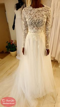 9e7b0aaa0858 Modest long sleeve wedding gown with a tulle skirt.