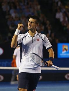 Novak Djokovic of Serbia celebrates after winning a game in his Quarterfinal match against Tomas Berdych of the Czech Republic during day nine of the 2013 Australian Open at Melbourne Park on January 22, 2013 in Melbourne, Australia.