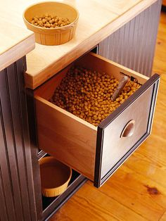 Clever Built in Storage Ideas for pet food storage I think there would need to be a few hygienic measures put in place, but I like this better than what we have at my house. Do we wanna have pets, Cara? I hadn't really thought about pet girl Clever Kitchen Storage, Pet Food Storage, Stuffed Animal Storage, Kitchen Storage Solutions, Kitchen Organization, Storage Ideas, Storage Baskets, Creative Storage, Smart Storage