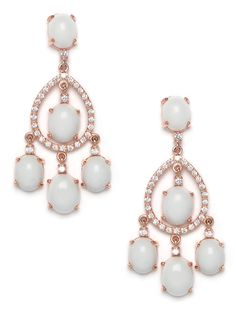 Tap into your inner diva with these gorgeous chandelier earrings. They feature a regal cascade of ivory-white gemstones, which are made all the more opulent with the rose-gold detailing and dazzling crystal accents.