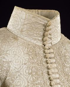 High collar & button detail.  Doublet, 1635-1640, England, Great Britain.  Glazed linen, embroidered with linen thread. | V Search the Collections
