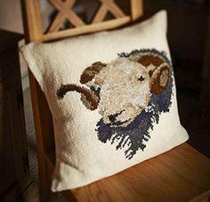 Herdwick Sheep Cushion - Pattern by Marie Wallin. Designed for Wool Week 2014, this striking intarsia cushion is handknitted using Rowan Fine Tweed.