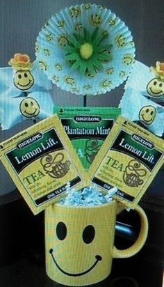 Smiley face mug tea and mints candy bouquet.