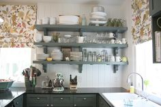 Urban Grace Interiors - Fantastic kitchen with green kitchen cabinets, green shelves, ...