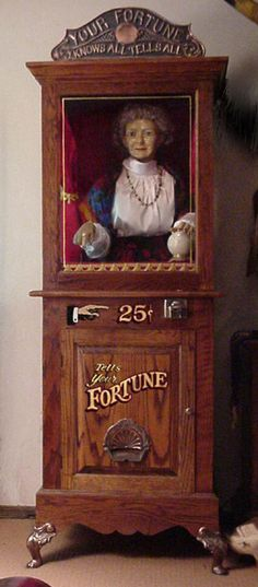An arcade or mid-way fortune teller. She is life size, breathes, nods, turns her head, chooses a Tarot card, and dispenses a fortune!