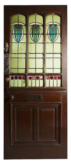 Glasgow School - Leaded Glass Paneled Door. Stained Wood with Brass Hardware and Clear & Coloured Glass with Lead Came Panels. Circa 1900. 212cm x 87cm.