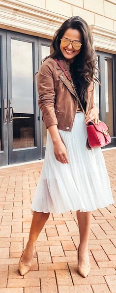 #spring #outfits woman in brown leather zip-up jacket posing for a photo. Pic by @lydia.webb