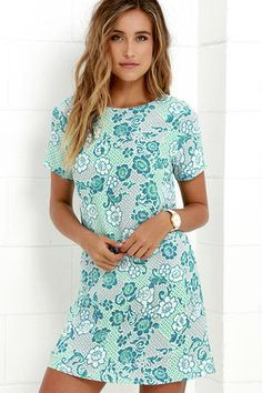 We are simply smitten with the Lucy Love Charlotte Turquoise Print Shift Dress! Lightweight woven shift dress has a turquoise, grey, and ivory print covering its bateau neckline and short sleeve, darted bodice. Three mother-of-pearl button closures at back.
