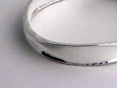 Hammered Organic Sterling Silver Bangle Bracelet by Edith Toledano.