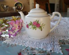 Vintage one cup teapot decorated with pink camelias and lily of the valley. Just perfect for that perfect cup of tea, Earl Grey perhaps! by Alexsprettyvintage on Etsy