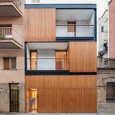 Squeezed between two blocks in Barcelona, this family home by Alventosa Morell Arquitectes takes the form of a timber and metal-framed box..