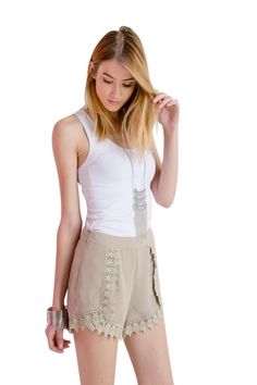 These woven crochet shorts are Great shorts for a spring or summer lunch with a flattering cut that elongates the legs. Choose from one of the two perfect essential colors. Comes in Taupe and black so you can't go wrong with either or both!